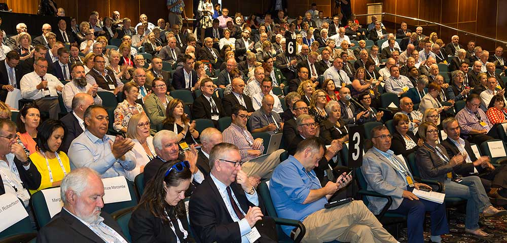 People seated in hall at Albury conference