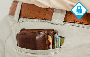 Picture shows wallet poking out of man's back trouser pocket.